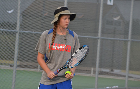 Tennis battles through three games