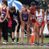 Senior Claire Crone waits at the starting line while rain suddenly begins to pour around her. Crone placed 52nd at the meet.