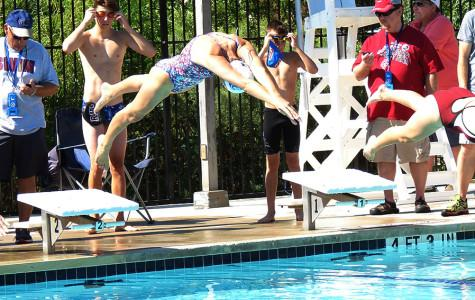 Swim team breaks several school records