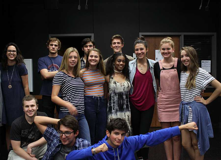 The cast of Big Love poses in the theatre room following the first rehersal. The cast will rehearse nearly every week until the show is performed on Mondays, Tuesdays, and Thursdays.