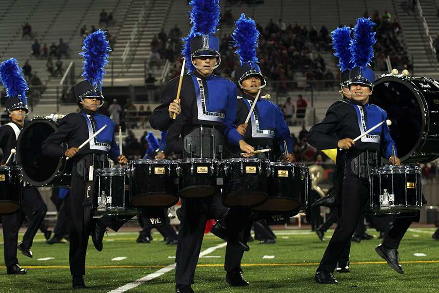 The Band performs during the Vista Ridge football game. Their show is called 'The Fourth Dimension'.