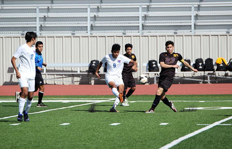 Senior Arturo Palomino passes a ball during their game against Marble Falls. They lost the game 0-2.