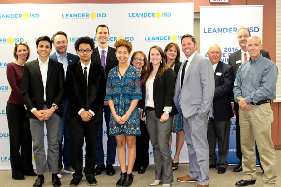 Some+of+the+members+of+the+Youth+and+Government+team+stand+for+a+photo+at+the+board+meeting.+Senior+Jared+Bouloy+was+selected+to+go+to+nationals.+