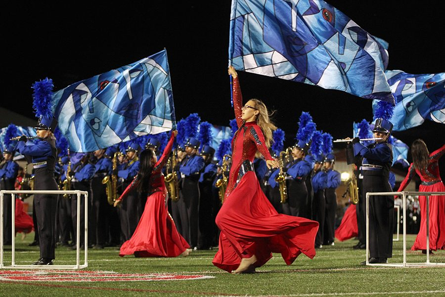 The+band+performs+their+show+The+Fourth+Dimension+during+a+game+against+Lake+Travis.+They+placed+as+the+6th+best+performance+in+the+nation.
