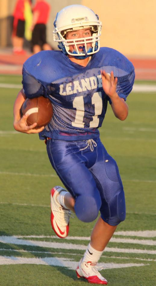 Kyle Irlbeck carries the ball up field during the third quarter.