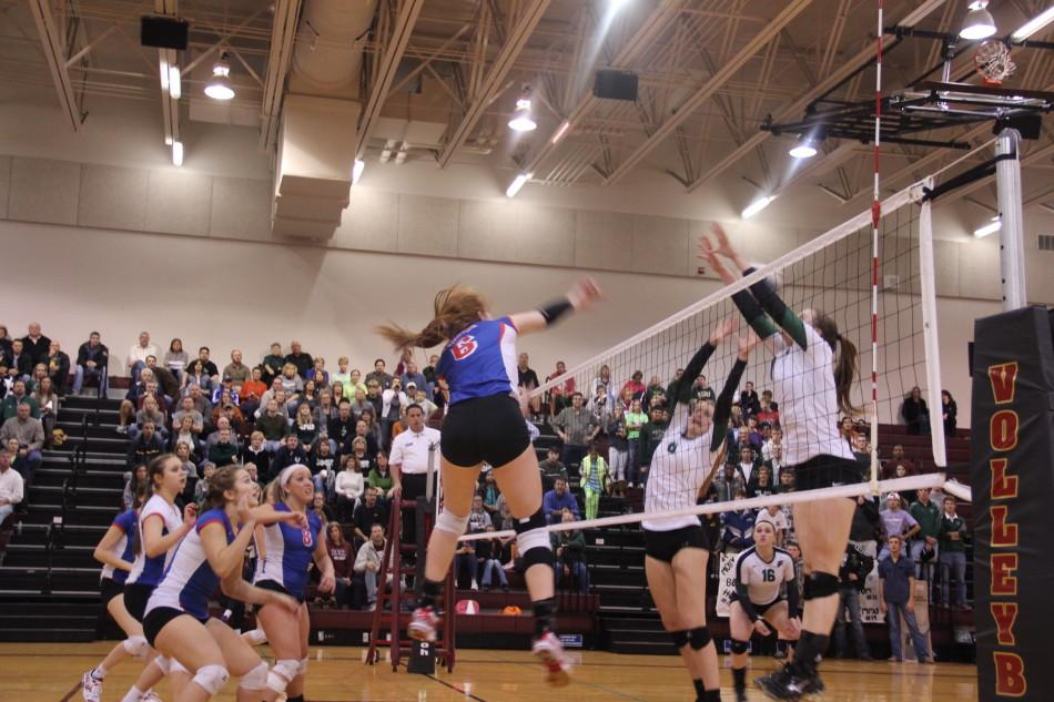 Junior+Autumn+Lockley+goes+up+for+a+kill+with+the+rest+of+the+team+ready+to+recover+the+block