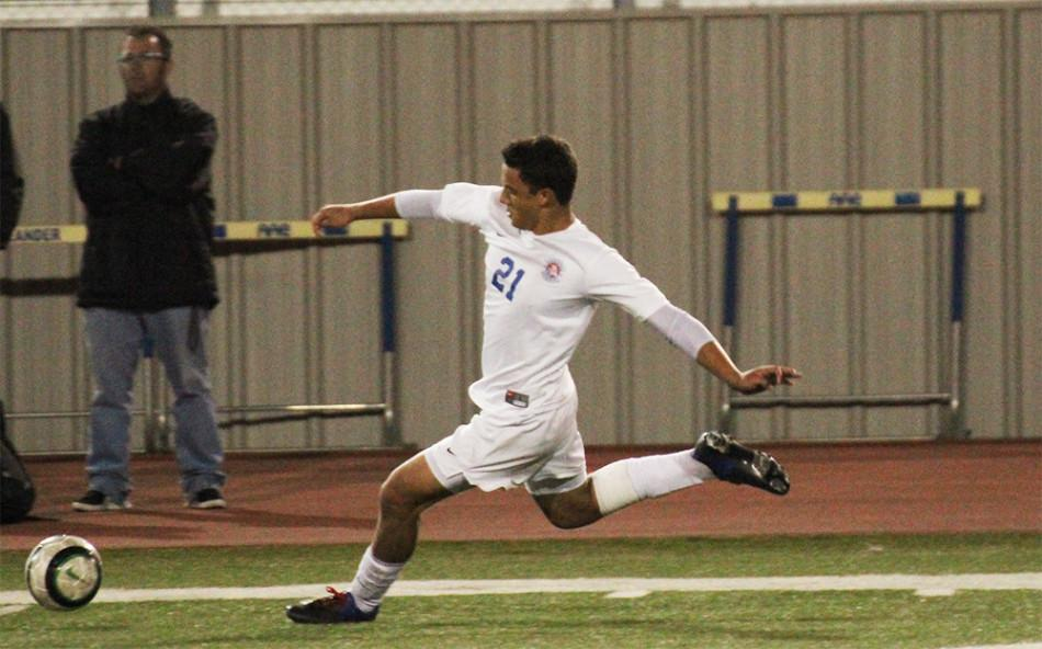 Junior Christian Vieira aims to kick to a fellow teammate in an attempt to make a goal in the second half of the Vandegrift game.