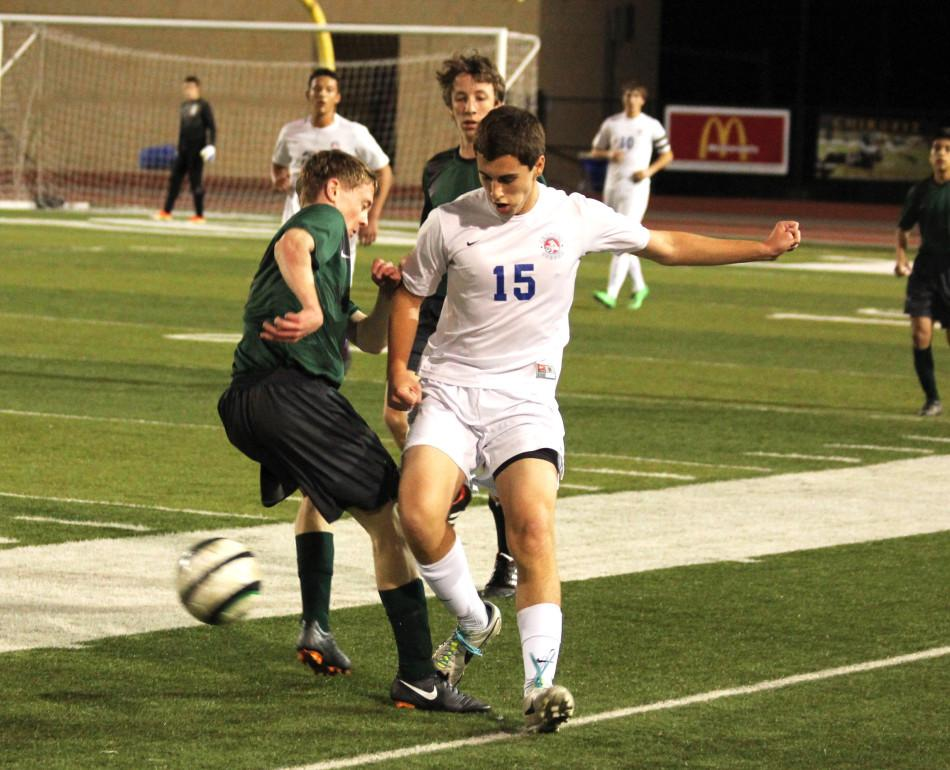 Junior David Uihlein wrestles for the ball during the second half of the Cedar Park game.
