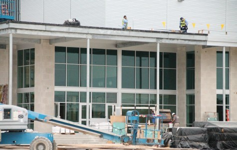 Construction workers finishing the new science building.