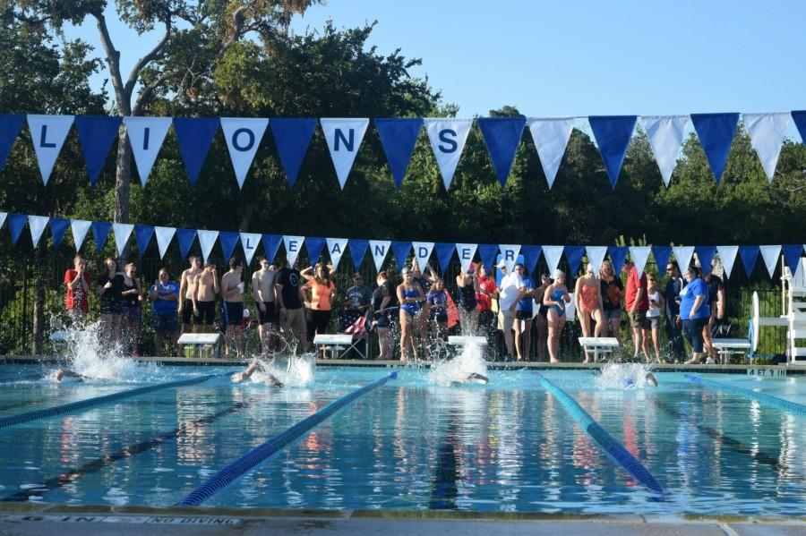 Four swimmers competing at the Lions' inter-squad meet.