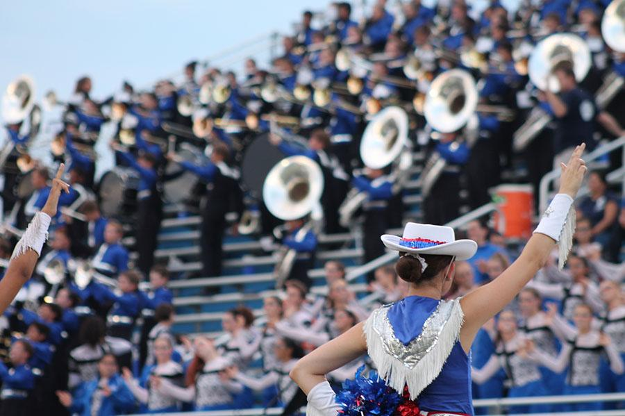 The+Blue+Belles+and+Color+Guard+put+up+their+L%27s+during+Leander%27s+school+song+played+by+the+band