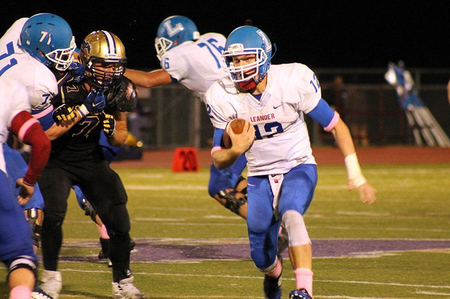 Senior+quarterback+Brandon+Hopp+on+the+keep+for+the+Lions