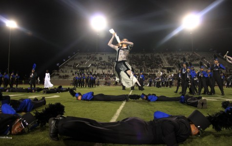 Senior Jocilyn Guerra leaps into the air during half-time in the football game against Cedar Park