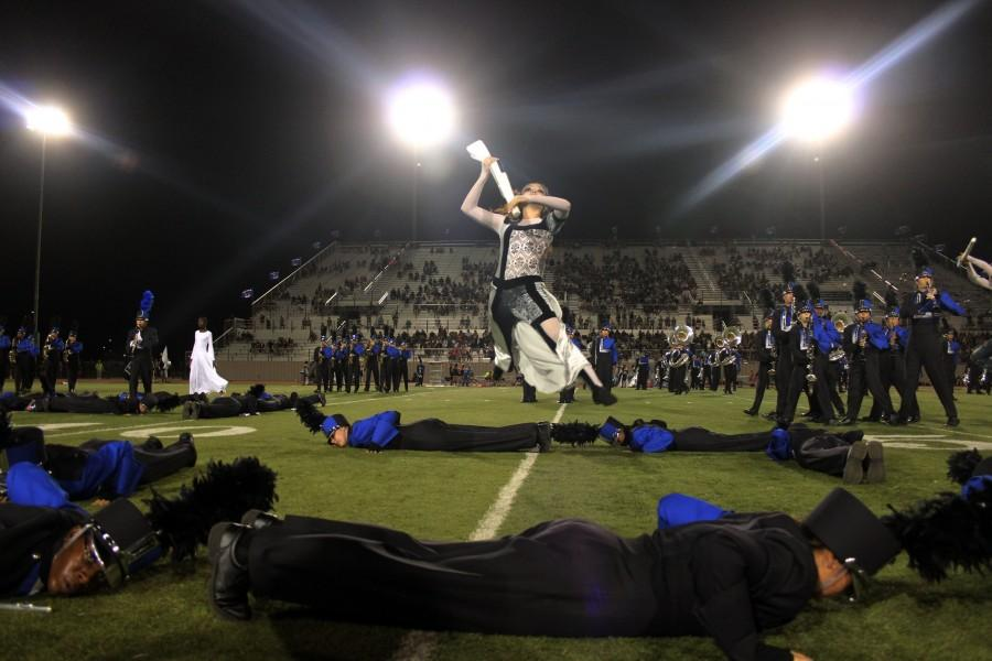 Senior+Jocilyn+Guerra+leaps+into+the+air+during+half-time+in+the+football+game+against+Cedar+Park