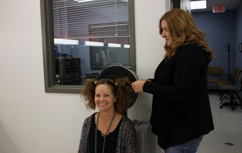 Mrs. Shaw gets her hair done by Mrs. Lozano, the cosmetology teacher