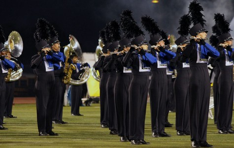 Band performs their show at the Eastview football game