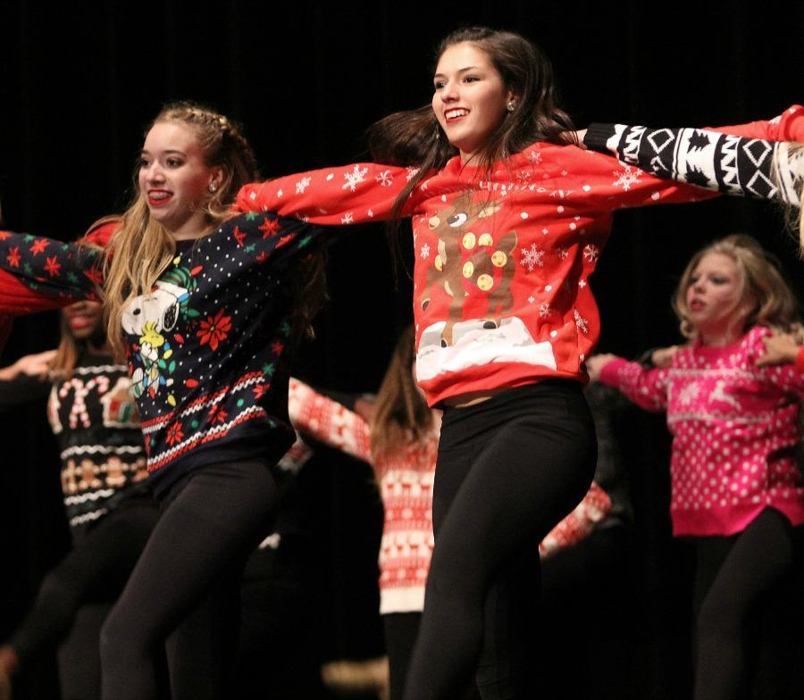 Katrina Malin and Amanda Young perform high kicks in the Christmas Pom routine.