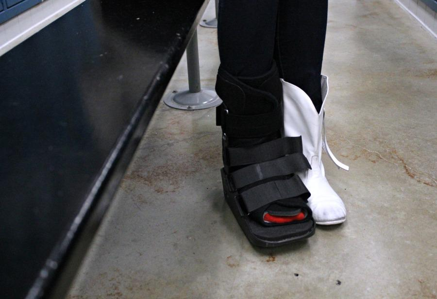 Sophomore+Hannah+Faubion+broke+her+foot+during+a+practice+and+now+has+to+wear+a+boot.