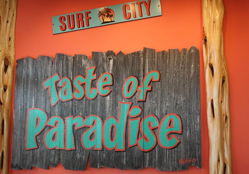 The interior of Bahama Buck's is mainly Caribbean themed which includes surf boards and signs