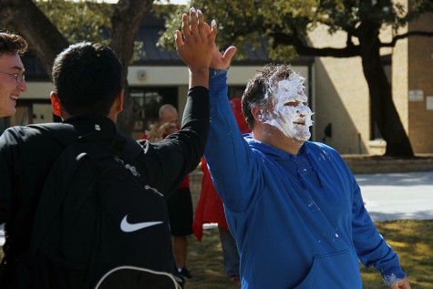 Coach Grissom high fives one of the students that gave him a face full of cream