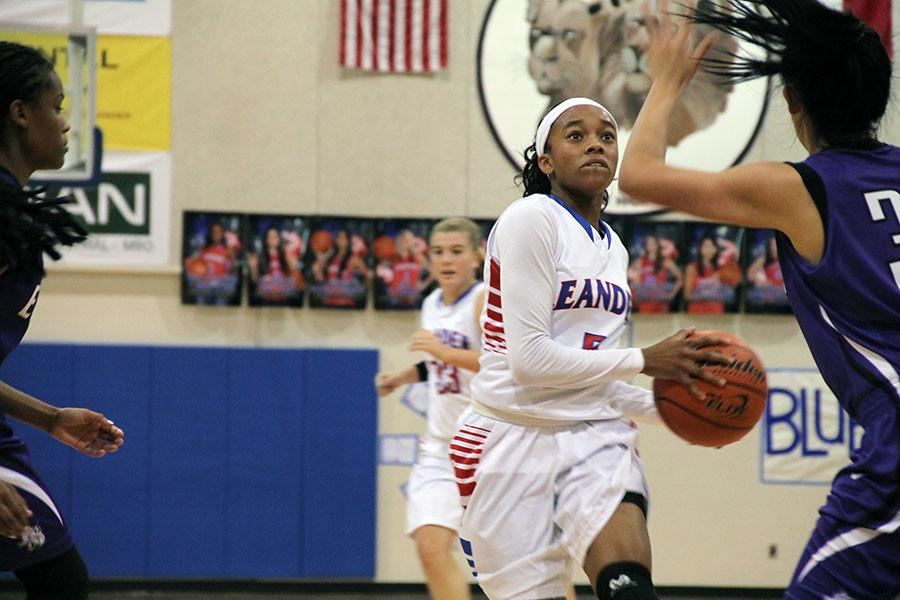Rayanna Carter defending the ball during the game against the Elgin Lady Wildcats