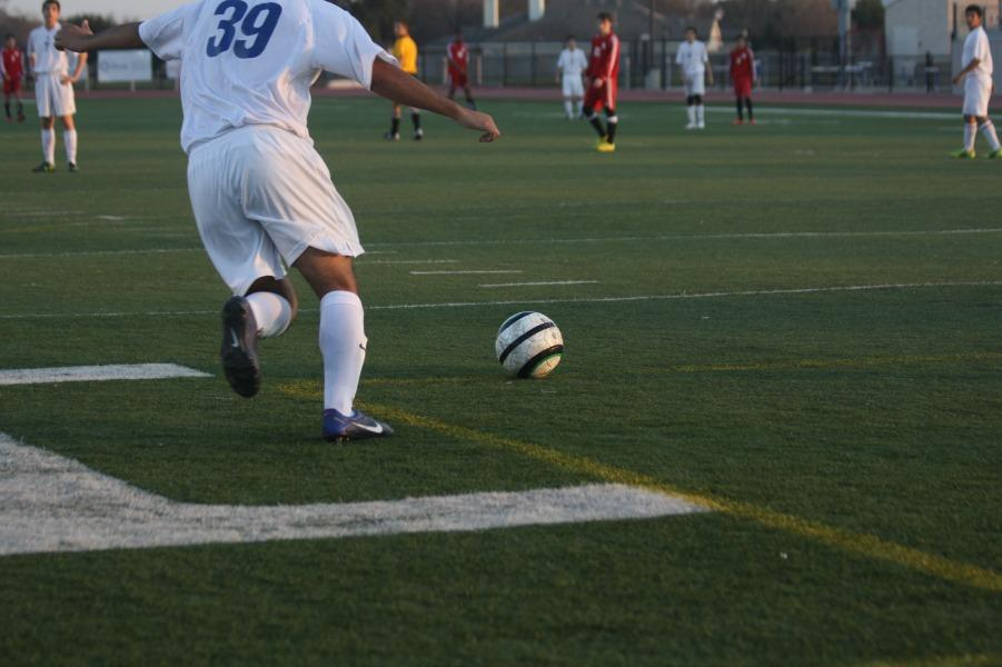 JV player kicking the ball back into play