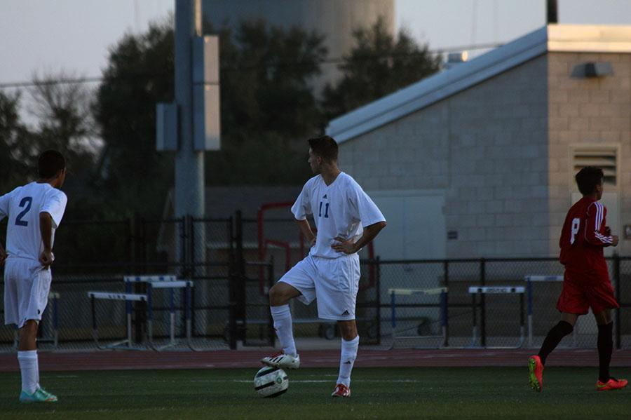 JV player Charlie Ruiz protecting the ball