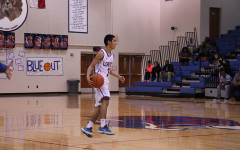 Freshman Ruben Luna preparing to dribble down to the basket