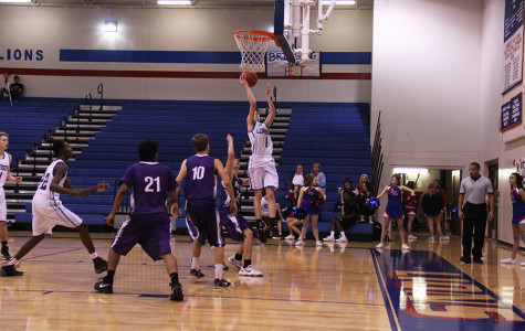 Sophomore Cody Bayer scoring a basket.