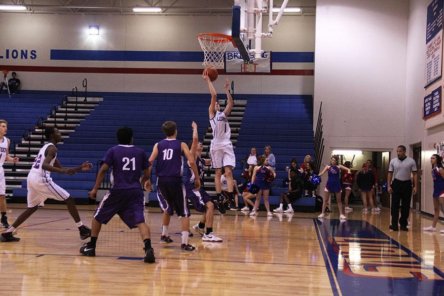 Sophomore Cody Bayer scoring a basket.