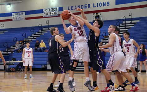 Sophomore Chase Cotton goes for a layup against Marble Falls
