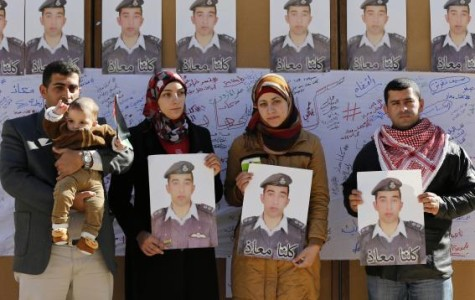 The Pilot killed by ISIS being remembered at a rally at the University in Amman.