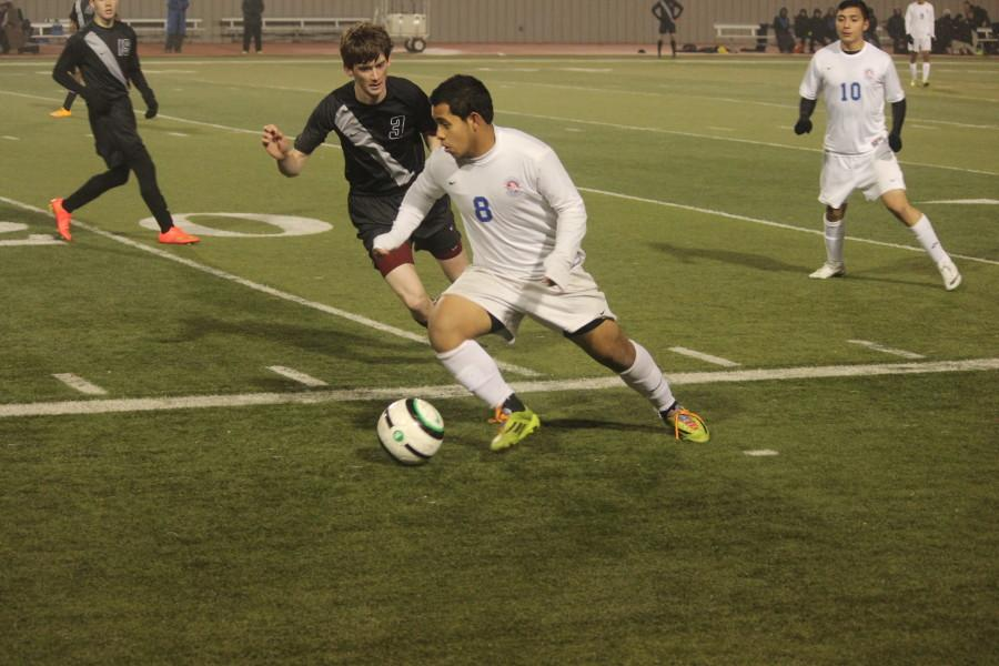 Senior+Jose+Cervantes+dribbles+the+ball+past+his+Vandegrift+opponent.