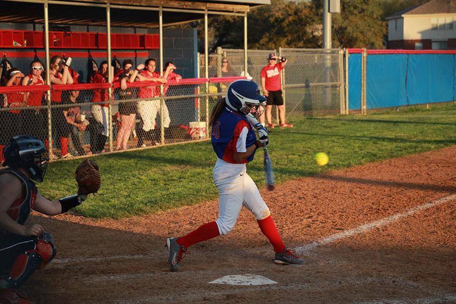 Junior Adrienne Vasquez hitting the ball against Eastview.