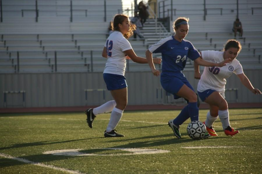 Junior Kathryn Boyd and  Sophmore Shelby Kawejsza working together to get control of the ball