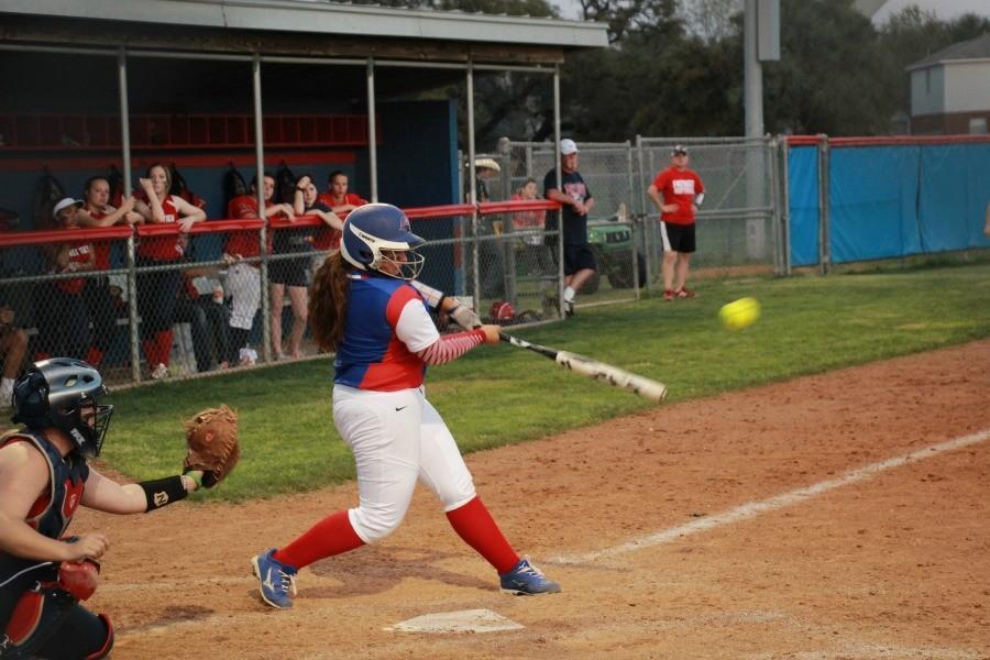 Senior Shelby Irlbeck hitting the ball.