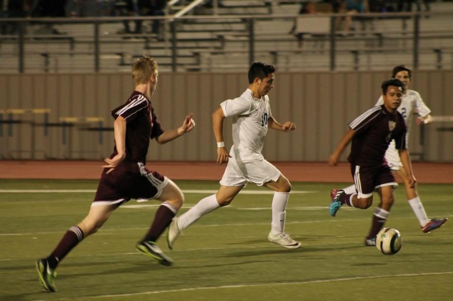 Senior Angel Garza dribbles the ball past the Tigers defense.