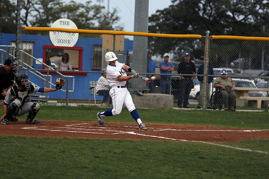 Senior Andrew Alaniz hits against Georgetown.