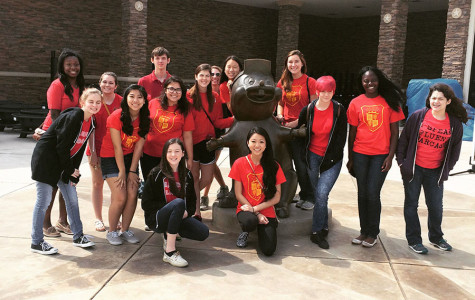 The Spanish National Honor Society posing with a Buc-ee's statue.