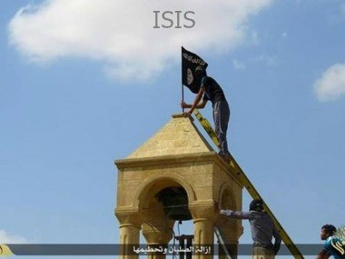 ISIS member suspects putting up a flag.