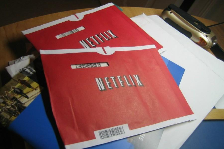 two packages of rented DVDs from Netflix