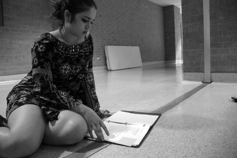 "Senior-director Chloe Berlinger contemplating her script for ""Dark Sonnets of the Lady"" the night of her performance."