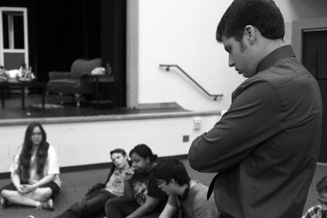 "Senior-director Josh Warren focusing hard on his cast during a line thru for the opening performance of ""Rhinoceros."""