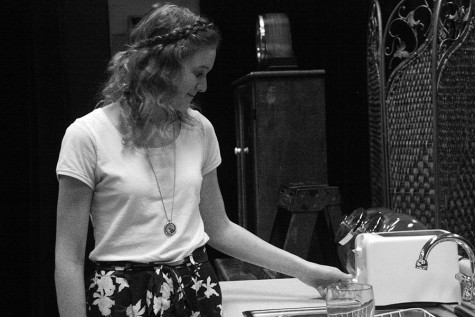 Sophomore actress Miranda Pizer having a moment to herself on stage while preparing the set.