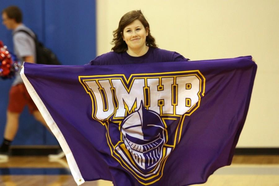 Senior Bryanna Edwards holding up her University of Mary Hardin-Baylor flag