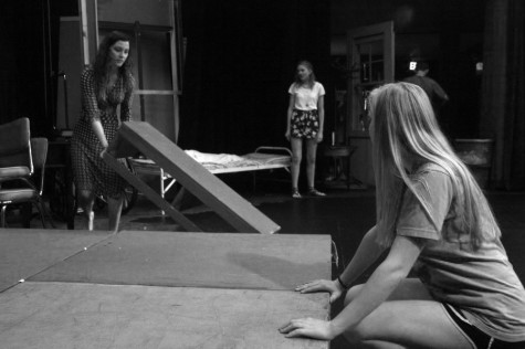 Senior-directors Alli Lesko(right) and Courtney Castillo(left) working on their set for 'Rabbit Hole.""