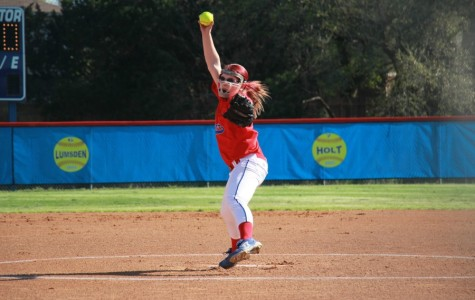 Freshman Lindsay Delvin throwing a pitch. Delvin's goal for next year is to earn the varsity pitching spot.