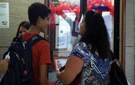 A student and his parent in front of the library at this year's open house. Parents and their children often go to open house to look at clubs, organizations, and other information.