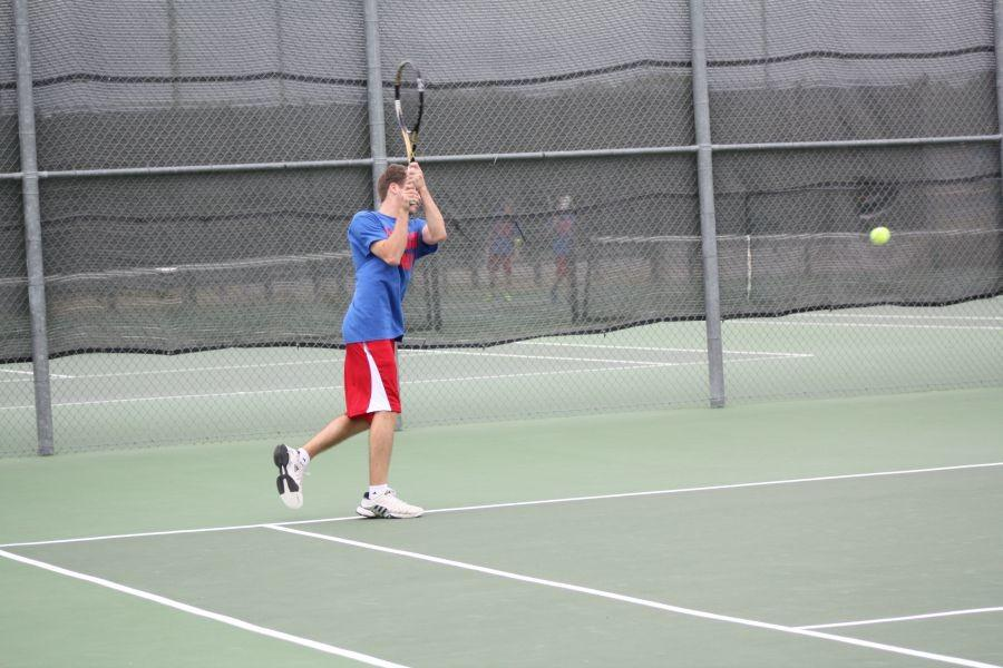 A Lions player hitting the tennis ball back to the opposing side. The Lions would later lose 15-4.