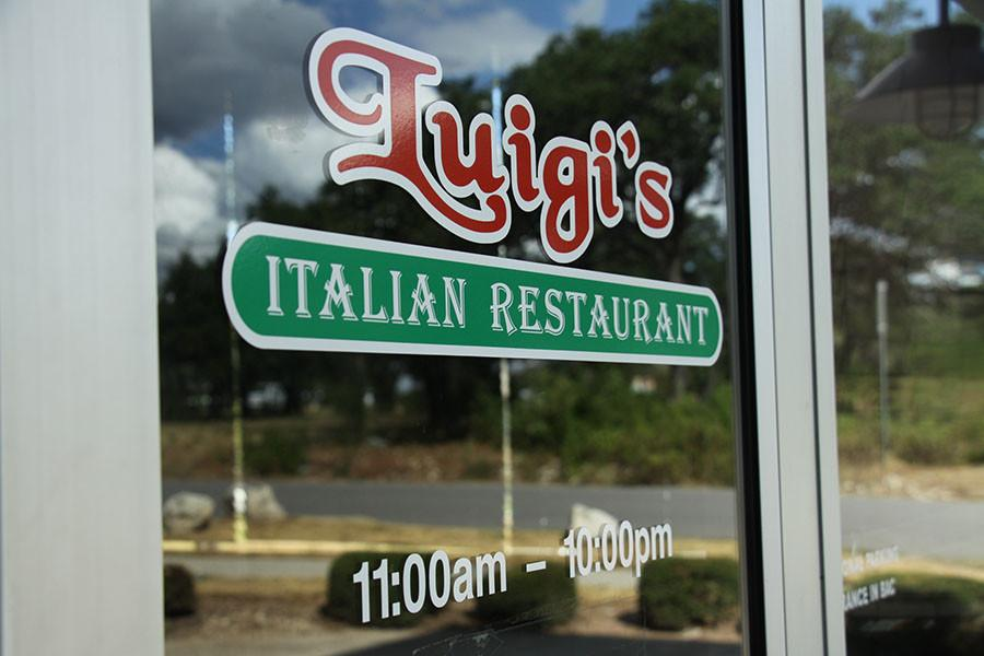 The sign for Luigi's has been removed from the building, but still stays pasted on the door.  Management hopes to reopen in 6 months to a year.